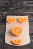 Orange, Half, Lobule. Healthy Lifestyle Concept. Orange, Half of Orange, Orange Lobule on the Wooden Table. Healthy Lifestyle Concept Stock Photography