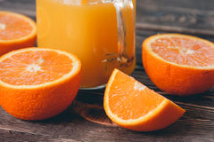 Orange, Half, Lobule. Healthy Lifestyle Concept. Orange, Half of Orange, Orange Lobule on the Wooden Table. Healthy Lifestyle Concept Stock Images