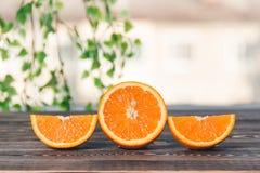 Orange, Half, Lobule. Healthy Lifestyle Concept. Orange, Half of Orange, Orange Lobule on the Wooden Table. Healthy Lifestyle Concept Royalty Free Stock Photo