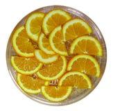 Orange half slices on the dish Stock Photo