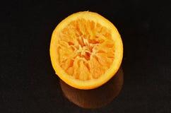 Orange half squeezed Stock Images