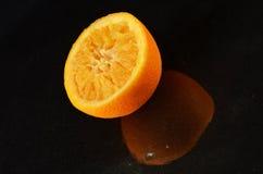 Orange half squeezed Stock Photo