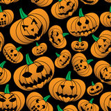 Orange halloween carved pumpkin seamless pattern Royalty Free Stock Images