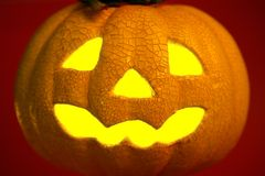 Orange halloween pumpkin. Glowing yellow light inside an orange halloween pumpkin Stock Image