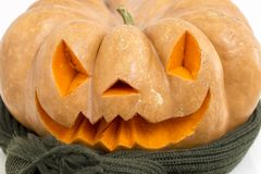 Real orange halloween pumpkin with carving. Orange halloween pumpkin with carving, crushed and collapsible typology, on a background in nature or white royalty free stock photos