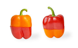 Orange halverade peppar som är röda och Fotografering för Bildbyråer