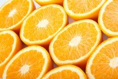 Orange halves. On white background Royalty Free Stock Photos