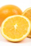 Orange halves tall close. Orange halves tall isolated against white with copy space Royalty Free Stock Photo