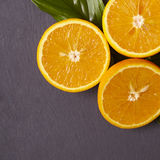 Orange Halves. On a wooden background Stock Photography