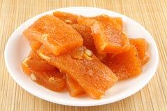 Orange Halwa. Plate of traditional tasty orange halwa Royalty Free Stock Photos