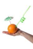 Orange in hand. Orange on white background, photo, umbrella,tubule,hand Royalty Free Stock Photography