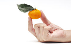 Orange in hand. This ia a Orange in hand inisolated shot Stock Photo