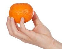 Orange in a hand Stock Photos