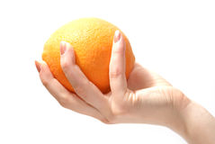 Orange in hand. Tasty sweet orange in graceful woman's hand royalty free stock image