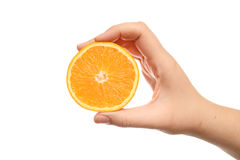 Orange in hand Stock Photos
