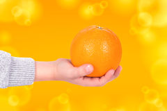 Orange in hand Royalty Free Stock Photography