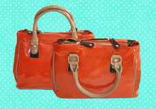 Orange handbag. On polka dotted background Royalty Free Stock Photo