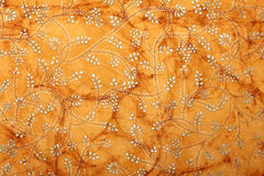 Orange handmade art paper with floral design royalty free stock photos