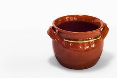 Orange handmade fictile pot in a white background Stock Photo