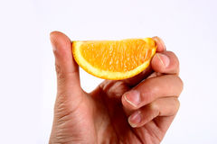 Orange hands. Hands with orange on white background Royalty Free Stock Photography