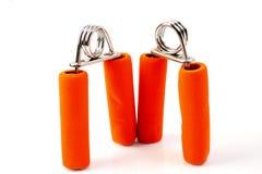 Orange Handtrainer lokalisiert Stockbild