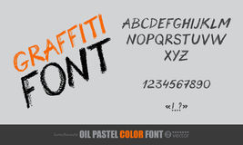 Orange handwritten letters on black background. Royalty Free Stock Photo