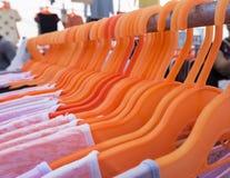 Orange hangers Stock Photography