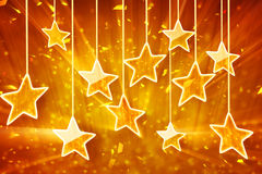 Orange hanging stars and bokeh lights. Computer generated abstract festive background Royalty Free Stock Photos