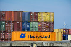 Orange Hapag-Lloyd container placed at the shore. Royalty Free Stock Image