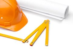 Orange hard hat, druft and foot rule Royalty Free Stock Photo
