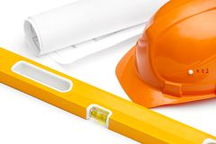 Orange hard hat, druft and level Stock Photography