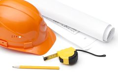 Orange hard hat, druft, pencil and tape measure. Isolated on white Stock Images