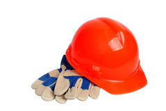 Orange hard hat and work gloves Stock Photos