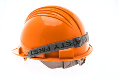 Orange Hard Plastic Construction Helmet On White Background . Royalty Free Stock Photo