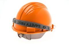 Orange Hard Plastic Construction Helmet On White Background . Stock Image