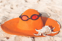 Orange hat on the sandy beach Stock Photography