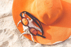 Orange hat on the sandy beach Royalty Free Stock Images