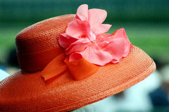 Orange hat with silk flower. Closeup of a bright orange hat and silk flower at the Kentucky Derby Stock Photo
