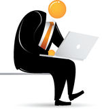 Orange Head Man Sitting with laptop Stock Photography