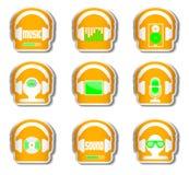 Orange headphone för musikuppsättning 9 med grejen Arkivfoton