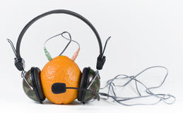 Orange and headphones Stock Image