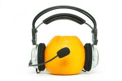 Orange and headphones stock photography