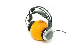 Orange and headphones Royalty Free Stock Photos