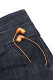 Orange Headphones in Denim Pocket Stock Image