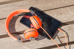 Orange headphones and tablet pc Royalty Free Stock Photo