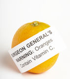 Orange with health warning. The near future? A health warning on a Orange by the Surgeon General Royalty Free Stock Photos