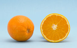 Orange healthy nutrition fruits  blue background Stock Images