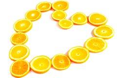 Orange heart. Heart made of orange rings isolated on white Royalty Free Stock Photography