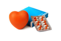 Orange heart and box with a medicine. Stock Photography