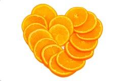 Orange heart. Of fruit on a white background Stock Photos